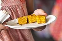 Itoman, Okinawa, Japan: barbecued corn during a wedding party at Bibi Beach
