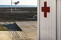 A white wall first aid in Playa Lisa beach, Alicante province, Spain