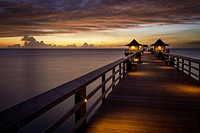 Colorful sunset over the Naples Pier, Naples, Florida, USA.