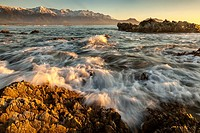 Dawn on limestone rocks, Kaikoura, Canterbury, New Zealand.