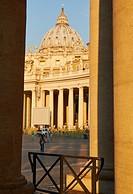 Dome of Basilica Di San Pietro through the perimeter columns, St Peter´s Square, Rome, Lazio, Italy, Europe.