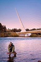 Fisherman in front of the Sundial Bridge on the Sacramento River, Redding, California.