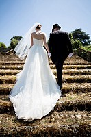 bride, groom, matrimony, matrimonial, getting, married, just married, together, walk, walking, up, stairs, staircase, Italy, Italian, gown, wedding da...