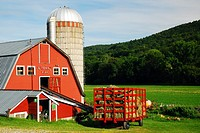 A red barn contrasted against the green hills of Southern Vermont.