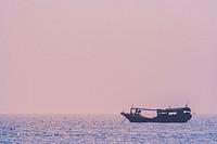 Hainan Island, China - The view of a fishing ship anchoring off the shore.