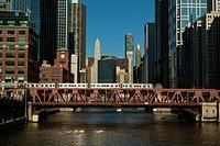 L train on Wells Street Bridge over Chicago River in Chicago, Illinois, USA.