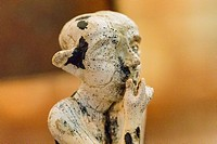 Egypt, Cairo, Egyptian Museum, statuette coming from Tell el Farkha, early Dynastic period, in hippopotamus tusk. Sitting boy.