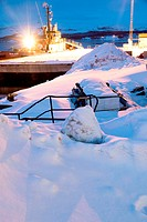 Kirkenes is a town in Sor Varanger municipality in Finnmark county, the far northeaster part of Norway. The harbor at dusk Barents sea.