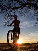 Cyclist near Peña del Águila reservoir, Badajoz province, Extremadura, Spain