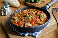 Smoky chicken and bean stew in a pan.