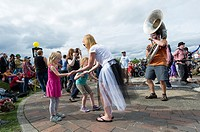 Seattle, Washington: Crowd gathered on the Great Mound at Gas Works Park after the Summer Solstice Parade and Festival. The annual event is produced b...