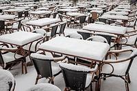 Germany,Berlin,Hackescher Markt-emty restaurant tables covered in snow.