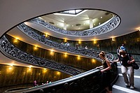 Visitors descend the famous spiral staircase in the Vatican Museum in Rome, Italy.