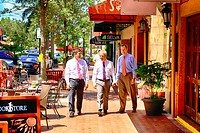 Three business men walking up Lower Main Street in downtown Sarasota.