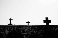 Three crosses in a cemetery.