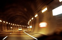 Fast car driving in a tunnel.