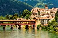 Bassano, Province of Vicenza, Veneto, Italy. Historic wooden bridge over Brenta River.