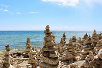 A large collection of rock totems, cairns, lining Lake Michigan´s shoreline at Cave Point County Park, Sturgeon Bay, Door County, Wisconsin, USA.