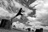 A Colombian parkour athlete performs a high jump during a free running training session of Tamashikaze team in a park in Kennedy, Bogotá, Colombia, 21...