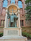 Statue of Phillips Brooks along side the Trinity Church on Copley Square in Boston, Massachusets. Brooks was rector of Holy Trinity Church and is know...