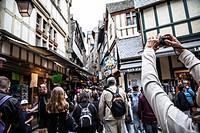 Visitors walk on medieval streets of Mont Saint-Michel, France.