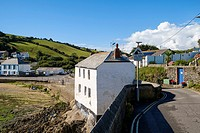 House built on rocks beside Portmellon Cove, Cornwall, England, United Kingdom.