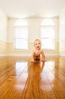 infant boy in an empty room.