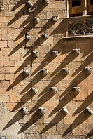 Shadows on the shells that decorate The Casa De Las Conchas, Salamanca, Spain.