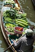 Vegetables floating market Damnoen Saduak outside Bangkok Thailand.