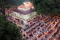 DHAKA, BANGLADESH - NOVEMBER 08 : Thousands of Hindu devotees sit with Prodip and pray to God in front of Shri Shri Lokanath Brahmachari Ashram temple...