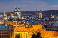 Night falls in Prague old town, Czech Republic. . The medieval church of Our Lady before Tyn dominates the city skyline.