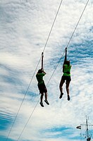 A man and a woman on a zip line, Halifax, Canada