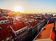 Portugal, Lisbon, Miradouro de Santa Justa, View over downtown and Aurea Street towards the Tagus River at sunrise.