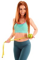 Young woman holding measure tape and apple. Weight loss.