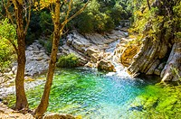 Emerald green water at the river Borosa in the Nature Park Sierra de Cazorla, Andalusia Spain.