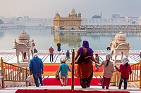 pilgrims and sacred pool Amrit Sarovar, Golden temple, Amritsar, Punjab, India.