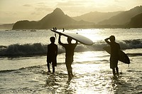 Surfers at Selong Blanak beach,South Coast,Lombok island,Indonesia.