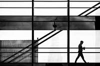 COPENHAGEN DENMARK Man walks in office building.
