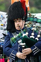 A marching pipe band performing at Highland Games. Aboyne. Aberdeenshire. Scotland. Europe.