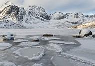 Landscape on the island of Flakstadoya, lake Storvatnet. The Lofoten Islands in northern Norway during winter. Europe, Scandinavia, Norway,February.