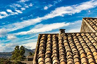 Volcano Etna - Italy. The ancient roof on a blue sky with clouds streaked.