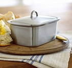 Brushed stainless steel butterdish in a kitchen