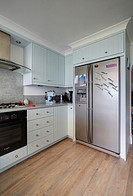 A duck egg blue maritime style kitchen in a home in the UK