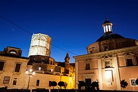 Royal basilica of Our Lady and Miguelete at twilight. Valencia, Spain.
