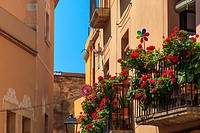 Bright flowers and plants on balconies in the old town of Tarragona, Catalonia, Spain.