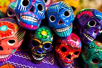 Colorful painted skulls (Calaveras) are sold on the market during the Day of the Dead holiday in Mexico City, Mexico, 28 October 2016. Skulls, skeleto...