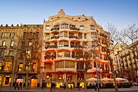 Casa Milà, better known as La Pedrera at dusk. Designed by the Catalan architect Antoni Gaudí in the Eixample district. Passeig de Gràcia, Barcelona, ...