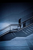 Man climbing stairs unrecognizable in a street at night. Barcelona, Catalonia, Spain