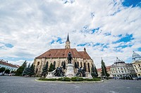Gothic style Roman Catholic Church of Saint Michale and monument of Matthias Corvinus on Union Square in Cluj Napoca city in Romania.