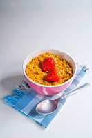 Cereals with strawberries for breakfast. Close view.